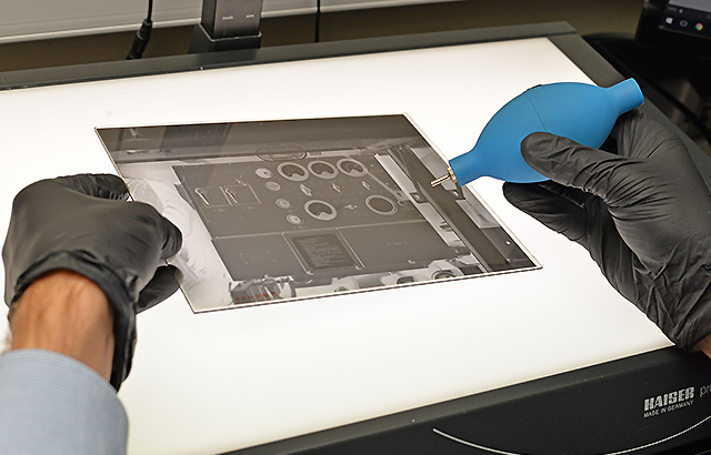 Cleaning glass plate negative before scanning