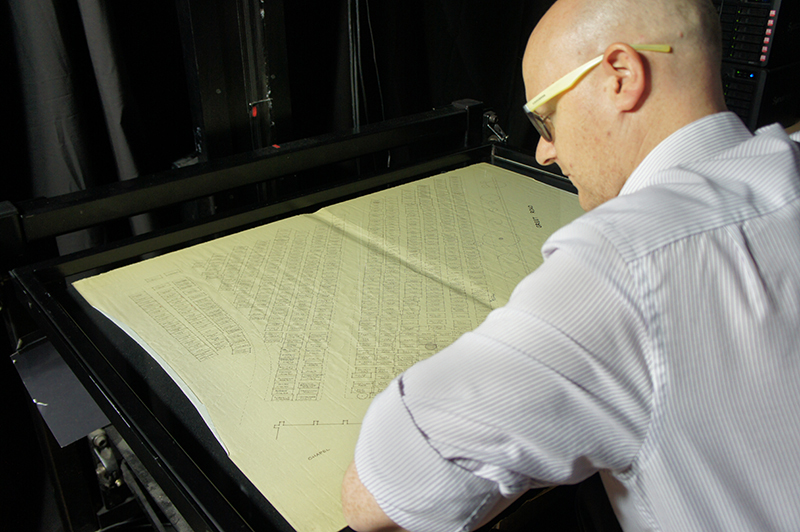 Digitisation Technician scanning Winchcombe Town Council burial plot map