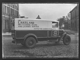 Lakeland dry cleaning lorry parked on cobbled street
